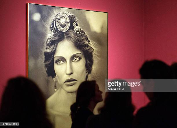 People crowd in front of a photo from German fashion designer Karl Lagerfeld's series Modern mythology 2013 in the exhibition Feuerbach's Muses...