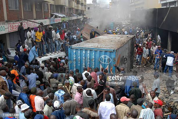 People crowd on June 5 2011 at the scene of an explosion in the Kenyan capital Nairobion At least one person was reported killed and some 28 others...