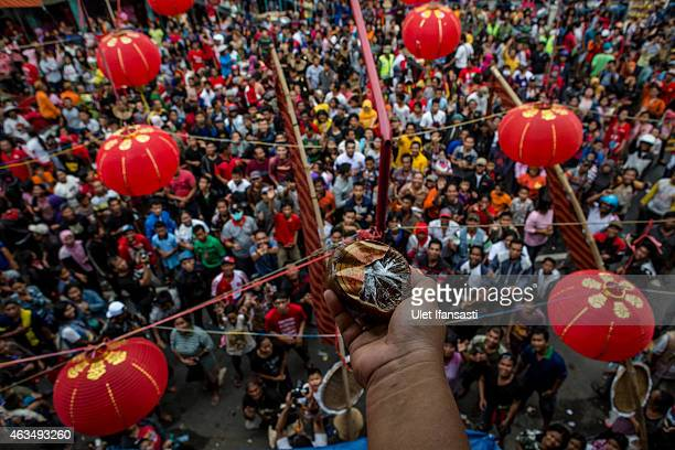 People crowd on the street as they scramble for Chinese sweetcakes during Grebeg Sudiro festival during Grebeg Sudiro festival on February 15 2015 in...