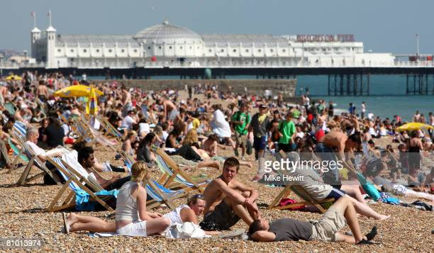 People crowd on to Brighton beach to enjoy the warm weather on May 7 2008 in Brighton England