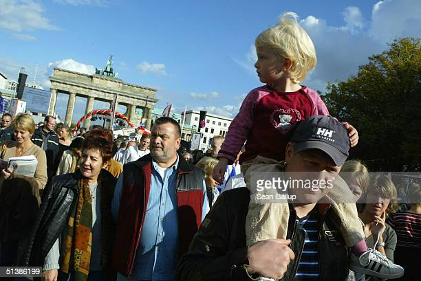 People crowd the avenue in front of the Brandenburg Gate on the 14th anniversary of German reunification October 3, 2004 in Berlin, Germany. Many...