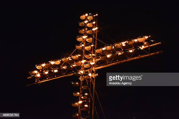 People crowd the Colosseum during the Via Crucis torchlight procession to be celebrated by Pope Francis in front of the Colosseum on Good Friday in...