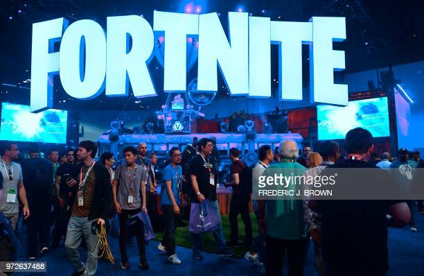 People crowd the display area for the survival game Fortnite at the 24th Electronic Expo, or E3 2018, in Los Angeles, California on on June 12 where...