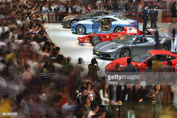 People crowd the exhibition area of auto companies during a special trade visitors opening of the Auto Shanghai 2009 at Shanghai New International...