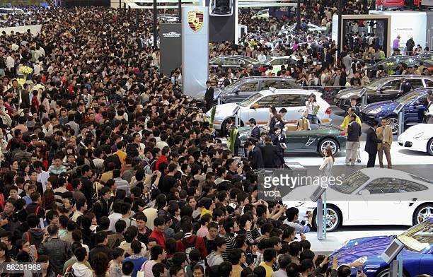 People crowd the exhibition area of auto companies during the 2009 Auto Shanghai at the Shanghai New International Expo Center on April 26, 2009 in...