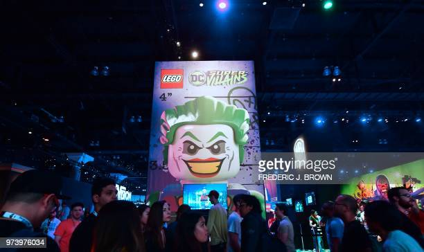 People crowd the floor past Lego's DC SuperVillains booth at the 24th Electronic Expo or E3 2018 in Los Angeles California on June 13 where hardware...