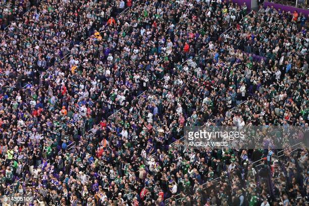 TOPSHOT People crowd the stands for the Super Bowl LII between the Philadelphia Eagles and the New England Patriots at US Bank Stadium on February 4...