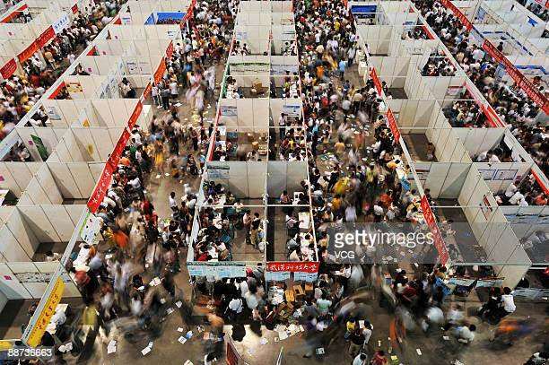 People crowd to attend a university consulting fair on June 28 2009 in Wuhan of Hubei Province China More than 102 million students sat for China's...