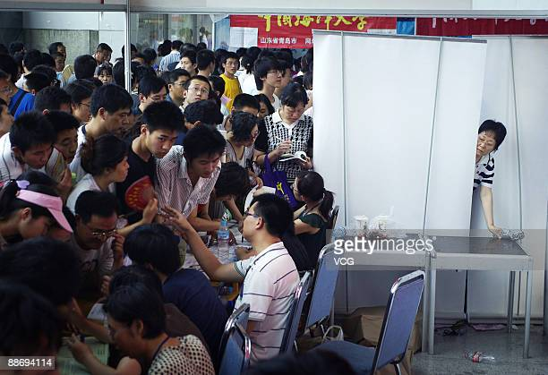 People crowd to attend the 2009 Shandong University Consulting Fair on June 25 2009 in Jinan of Shandong Province China More than 102 million...