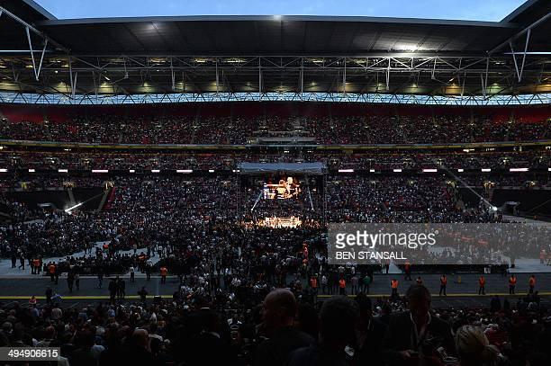 People crowd Wembley Stadium in north London on May 31 2014 to watch the WBA and IBF supermiddleweight title fight between British boxers Carl Froch...