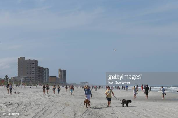 People crowded the beaches in its first open hour on April 17 2020 in Jacksonville Beach Fl Jacksonville Mayor Lenny Curry opened the beaches to...