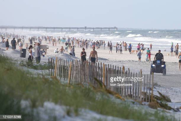 People crowded the beaches in its first open hour on April 17, 2020 in Jacksonville Beach, Fl. Jacksonville Mayor Lenny Curry opened the beaches to...