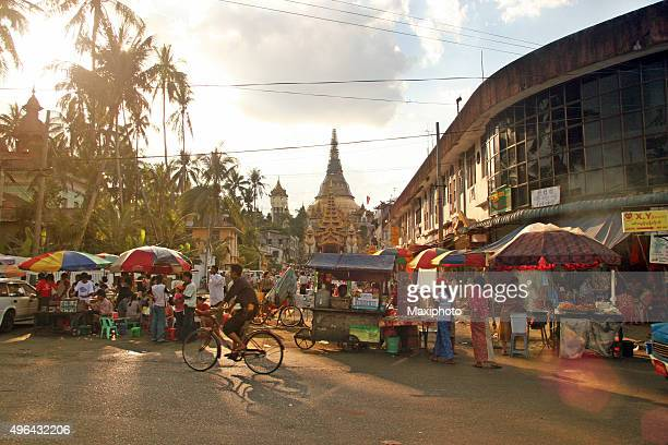 people crowding a street market in yangon, myanmar - yangon stock pictures, royalty-free photos & images