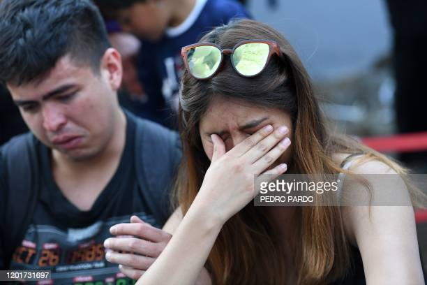 People cry after the burial of a sevenyearold girl whose body was found over the weekend with signs of torture at a cemetery in Mexico City on...