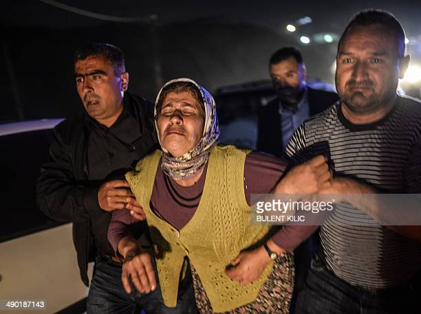 People cry after their relatives died in an explosion in Manisa on May 13, 2014. Four miners were killed and as many as 300 trapped after a mine...