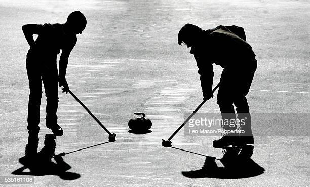 People curling at the St Moritz Curling Club in St. Moritz, Switzerland.