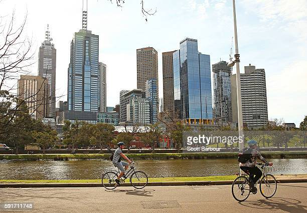 People cycle along the Yarra River on August 18 2016 in Melbourne Australia Melbourne has been named as the world's most liveable city for a sixth...