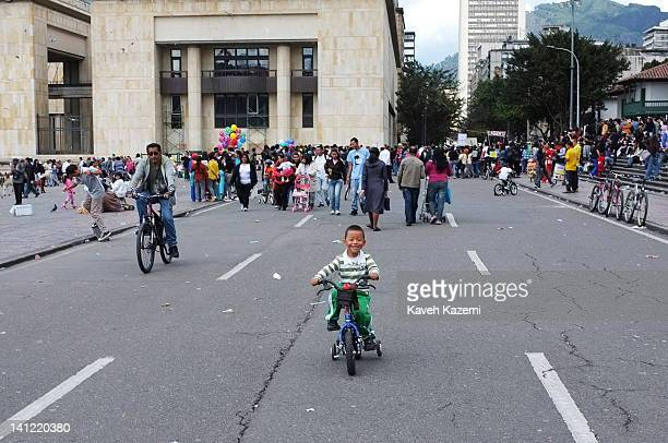 People cycle and jog in Bolivar square in downtown on January 29 2012 in Bogota Colombia All main roads are dedicated for sports and cycling...