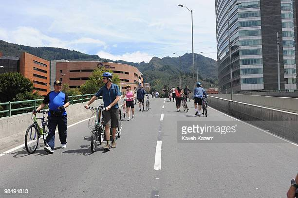 People cycle and jug all throughout the city on Sundays a day designated for people to do sports on the streets with special traffic facilities in...