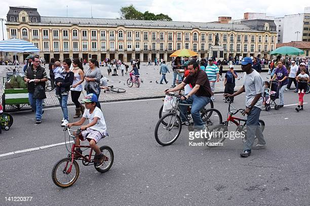 People cycle in Bolivar square in downtown on January 29 2012 in Bogota Colombia All main roads are dedicated for sports and cycling throughout the...