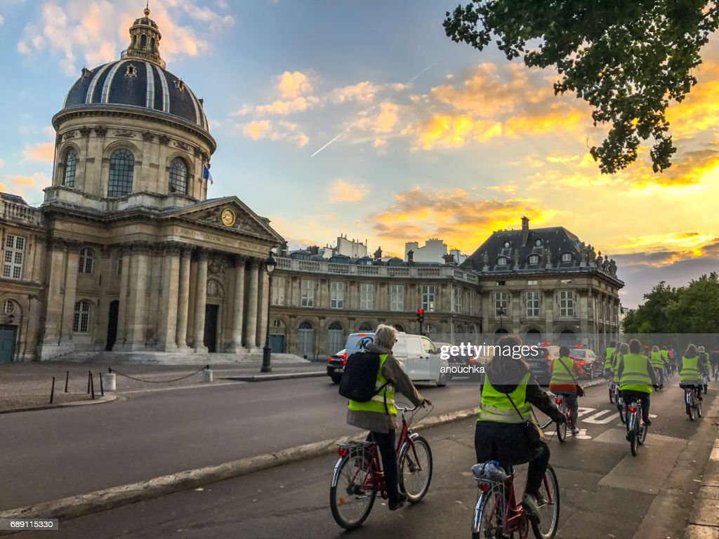 People cycling along Seine river in Paris, France : Stock Photo