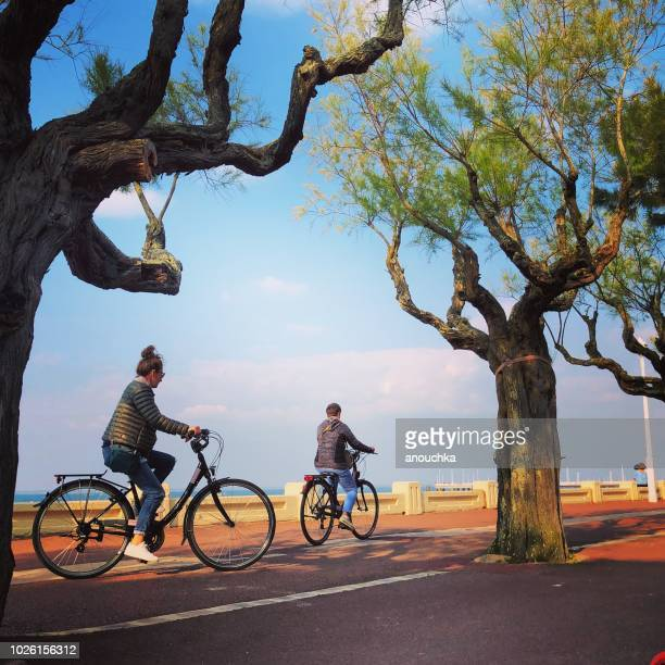 People cycling along the beach, Arcachon, France