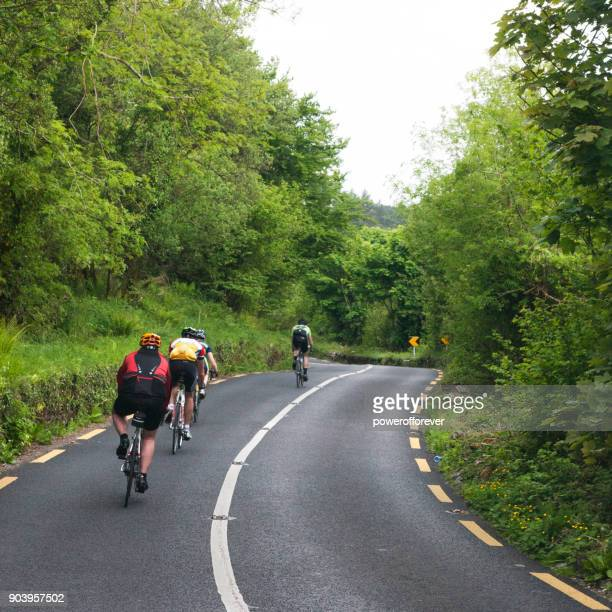 people cycling along the ring of kerry, ireland - ring of kerry stock photos and pictures