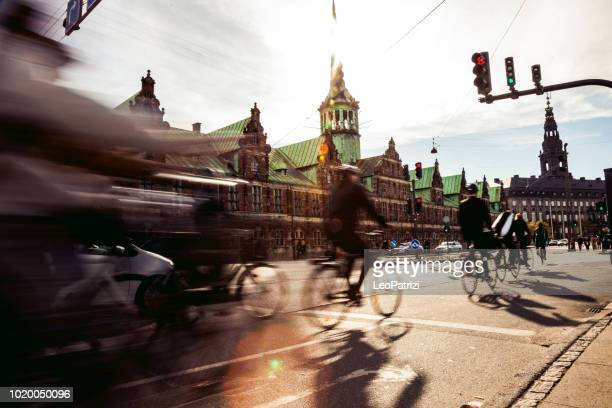 people cycling in copenhagen - copenhagen stock pictures, royalty-free photos & images