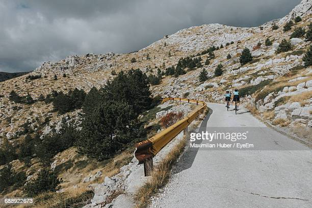 people cycling on mountain road - dalmatia region croatia stock pictures, royalty-free photos & images