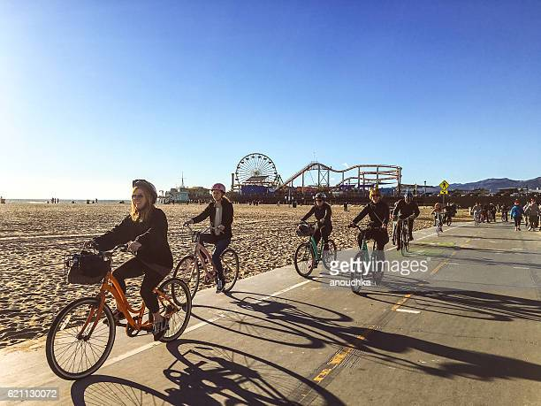 People cycling on Santa Monica beach, USA