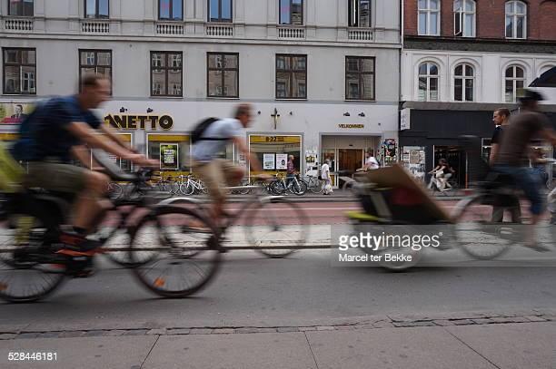 People cycling to work and school in Copenhagen Denmark