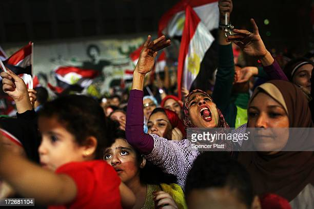 People dance and cheer in Tahrir Square, the day after former Egyptian President Mohammed Morsi, the country's first democratically elected...