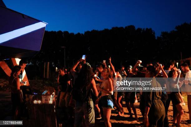 People dance and enjoy an open air party in Saint-Denis, north of Paris on August 1st, 2020. - It took an epidemic, the closure of clubs and a...