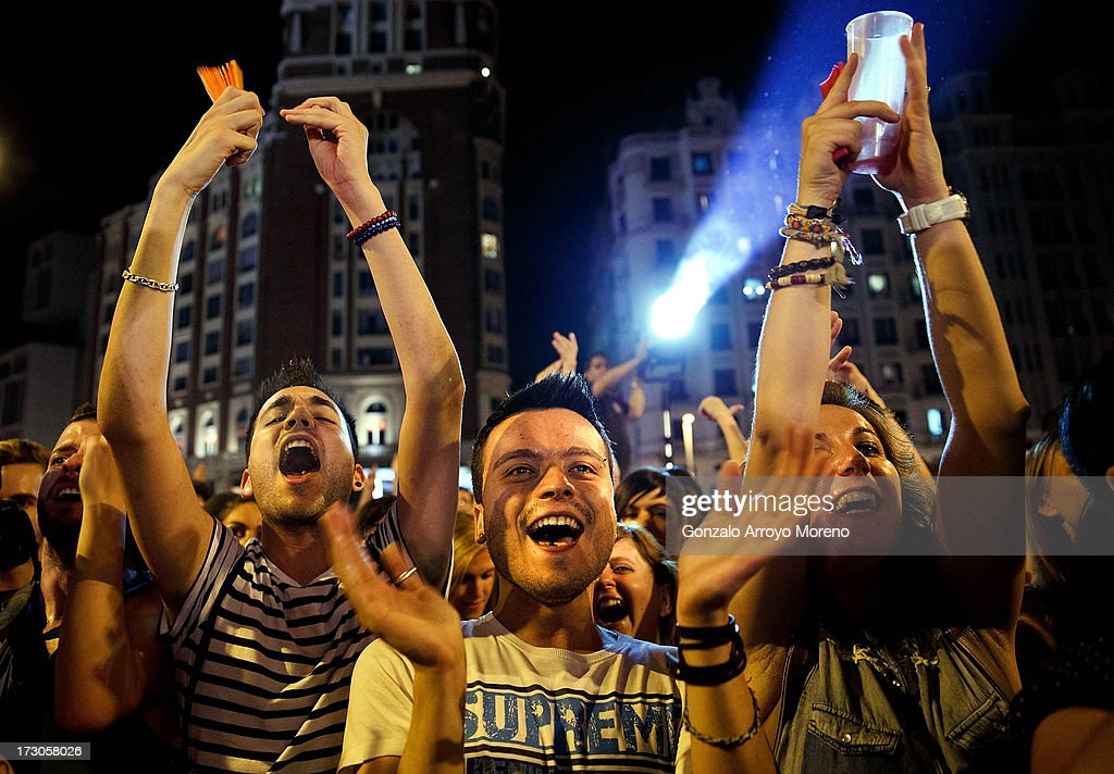 People dance and enjoy music at the Callao Square stage during the Mr. Gay Pride Gala at the Madrid Gay Pride Festival 2013 on July 5, 2013 in Madrid, Spain. According to a new Pew Research Center survey about homosexual acceptance around the world, Spain tops gay-friendly countries with an 88 percent acceptance rate.
