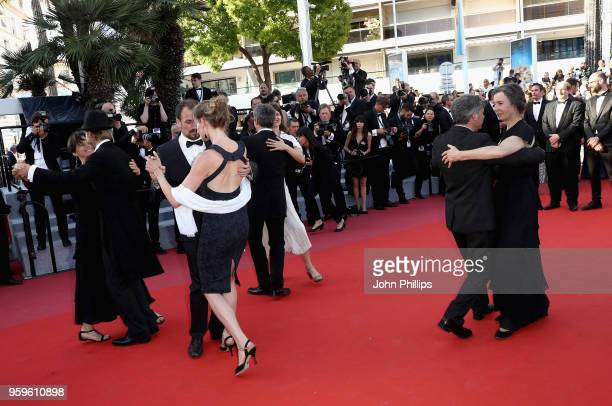 People dance and musicians play music on the red carpet at the screening of 'Capharnaum' during the 71st annual Cannes Film Festival at Palais des...