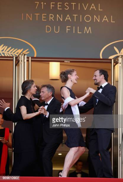 People dance and musicians play music on the red carpet at the screening of Capharnaum during the 71st annual Cannes Film Festival at Palais des...