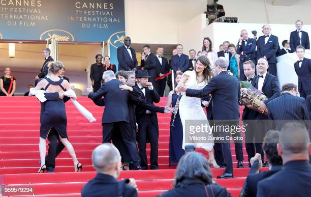 People dance and musicians play music on the red carpet before the screening of 'Capharnaum' during the 71st annual Cannes Film Festival at Palais...
