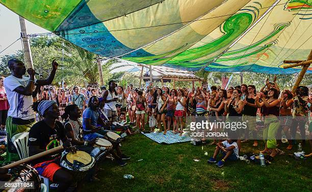 People dance and play music during the Rototom Sunsplash European Reggae Festival in Benicassim Castellon province on August 13 2016 The Rototom...