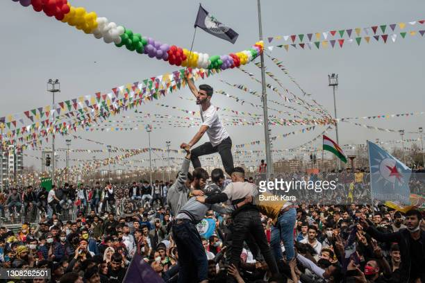 People dance and sing songs as they celebrate Newroz festivities on March 21, 2021 in Diyarbakir, Turkey. Newroz is the Kurdish celebration of...