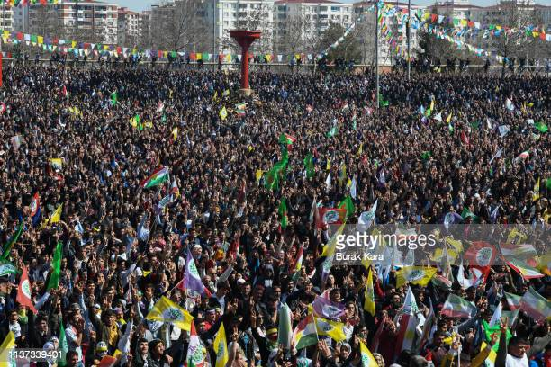 People dance and sing songs as they celebrate Nowruz festivities on March 21 2019 in Diyarbakir Turkey Nowruz marks the Persian New Year as well as...