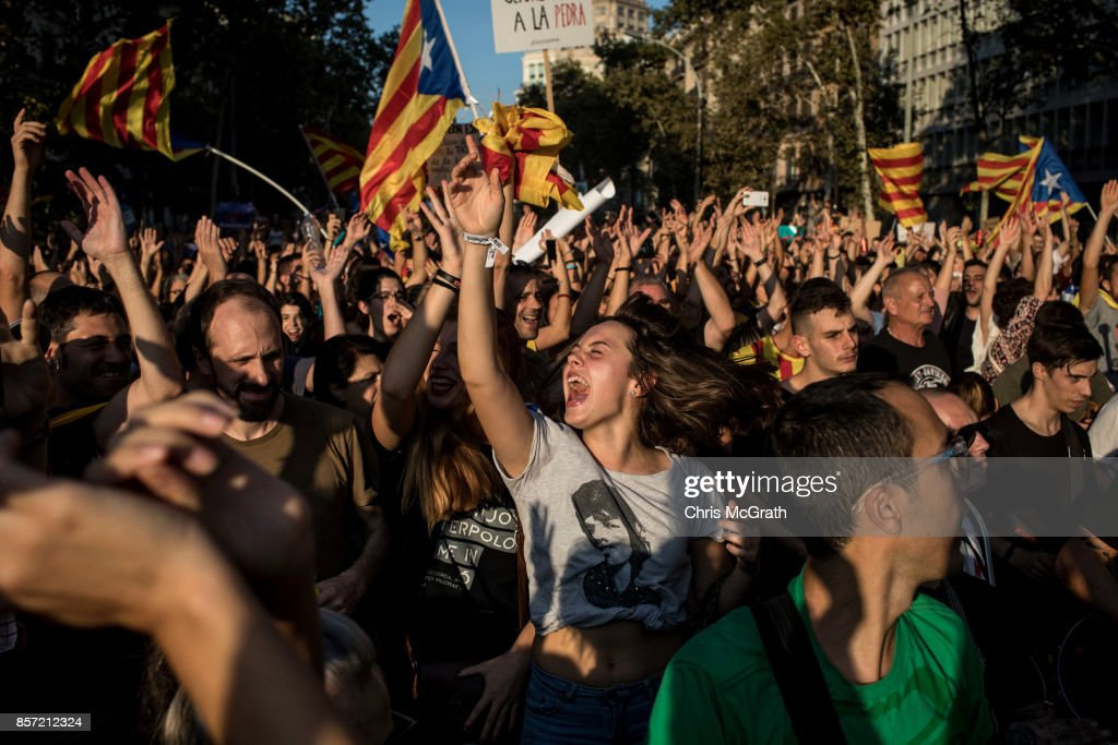 People dance and sing songs as thousands of citizens gather in Plaza Universitat during a regional general strike to protest against the violence that marred Sunday's referendum vote on October 3, 2017 in Barcelona, Spain. According to the Catalonia's government more than two million people voted on Sunday in the referendum of Catalonia, which the Government in Madrid had declared illegal and undemocratic. Officials said that 90% of votes cast were for independence. The Catalan goverment's spokesman said that an estimated of 770,000 votes were lost as a result of 400 polling stations being raided by Spanish police. Hundreds of citizens were injured during the police crackdown.