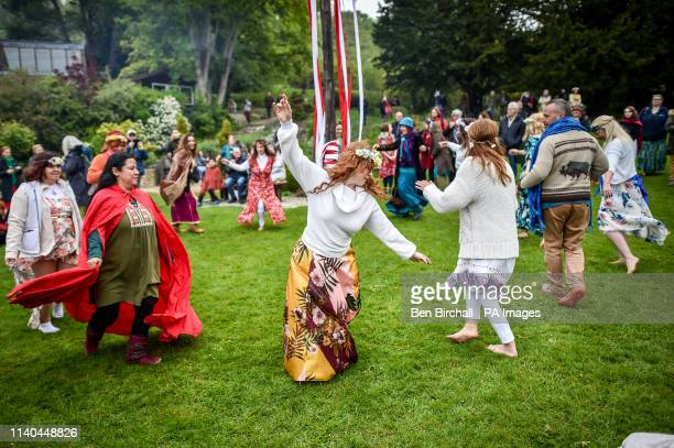 People dance around the maypole during the Beltane celebrations at Glastonbury Chalice Well where people gather to observe a modern interpretation of...