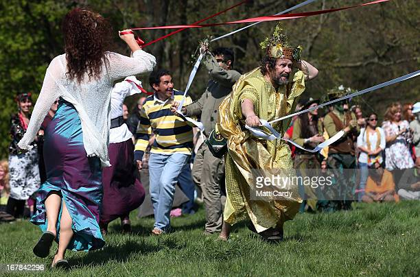 People dance around the Maypole used in a Beltane May Day celebration below Glastonbury Tor on May 1 2013 in Glastonbury England Although more...