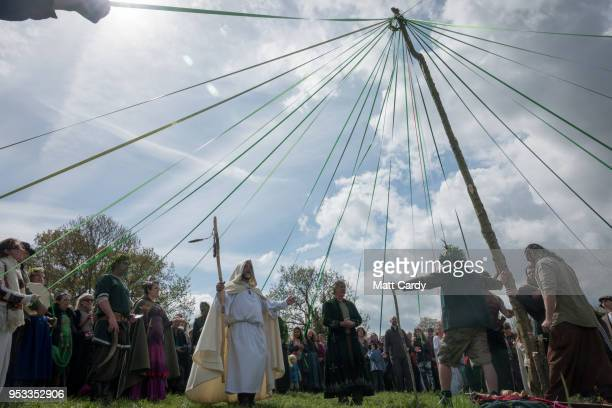 People dance around this year's Maypole at a ceremony at Bushy Combe below Glastonbury Tor as part of the town's Beltane May Day celebrations on May...