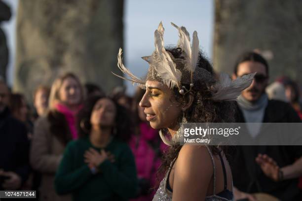 People dance as druids pagans and revellers gather at Stonehenge hoping to see the sun rise as they take part in a winter solstice ceremony at the...