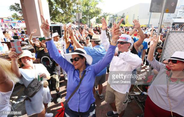 People dance as Mr Bryan of Cuba performs at Cubaocho during the annual Calle Ocho Festival in the Little Havana community on March 10 2019 in Miami...