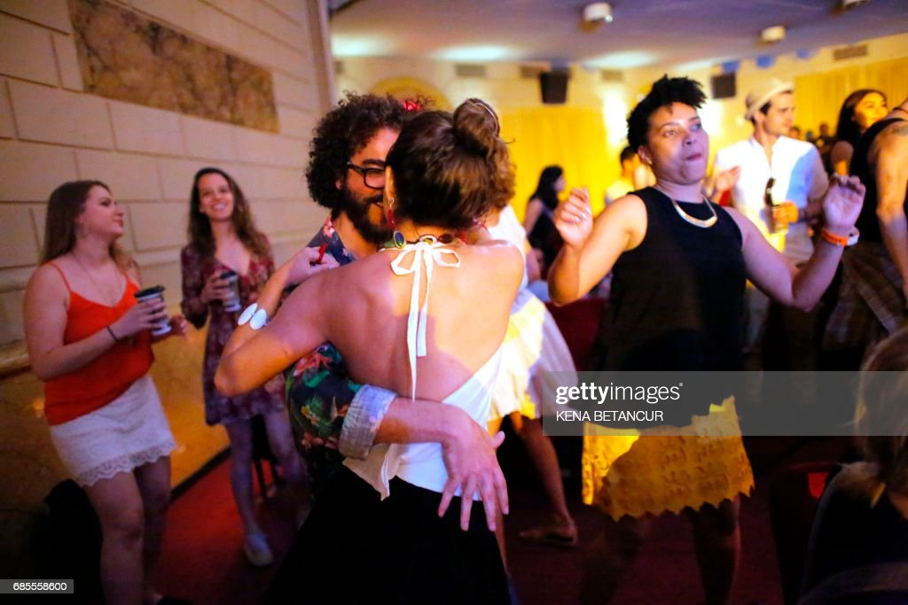People dance as the Brazilian group Forro in the Dark