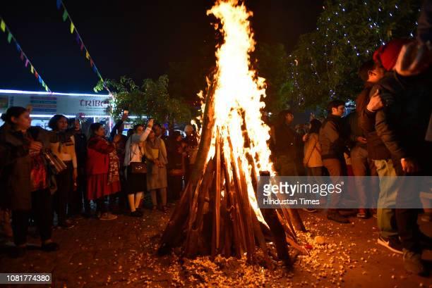 People dance as they celebrate Lohri festival at Dilli Haat, on January 13, 2019 in New Delhi, India. Lohri is a popular winter time Punjabi folk...