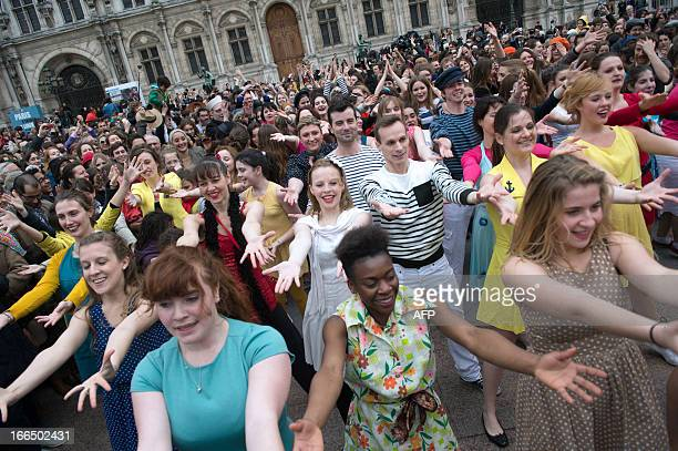 People dance as they take part in a flashmob organized by La Cinematheque Francaise on the theme of the film 'Les Demoiselles de Rochefort' by French...