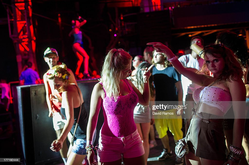 People dance at Privilege Club in Sant Rafael, on August 21, 2013 near Ibiza, Spain. The small island of Ibiza lies within the Balearics islands, off the coast of Spain. For many years Ibiza has had a reputation as a party destination. Each year thousands of young people gather to enjoy not only the hot weather and the beaches but also the array of clubs with international DJ's playing to vast audiences. Ibiza has also gained a reputation for drugs and concerns are now growing that the taking and trafficking of drugs is spiralling out of control.